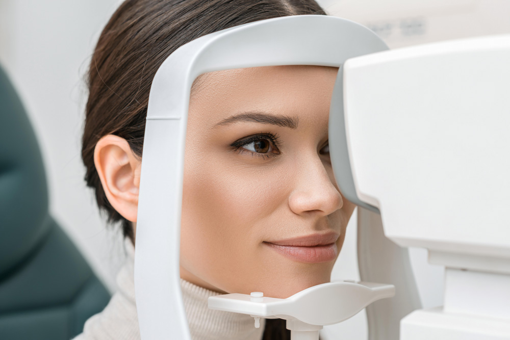 A woman having an eye exam shows improvement in vision after LASIK surgery