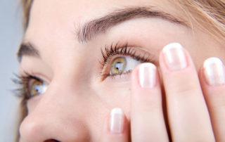 Staring eyes of woman who have had lasik eye surgery