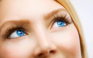 Beautiful blue eyed woman having LASIK side effects